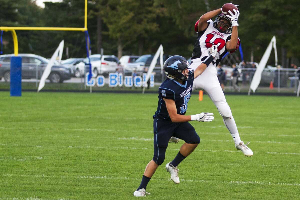 Beaverton High School senior Marcus Eberlein makes the catch while being defended by Meridian High School freshman Brady Solano in a game at Meridian High School on Friday.