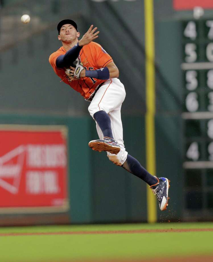 Houston Astros shortstop Carlos Correa (1) gets Los Angeles Angels catcher Carlos Perez (58) out at first in the fourth inning. Photos of MLB game action between Houston Astros and Los Angles Angels on  Friday, Sept. 23, 2016, at Minuet Maid Park in Houston. Photo: Elizabeth Conley, Houston Chronicle / © 2016 Houston Chronicle