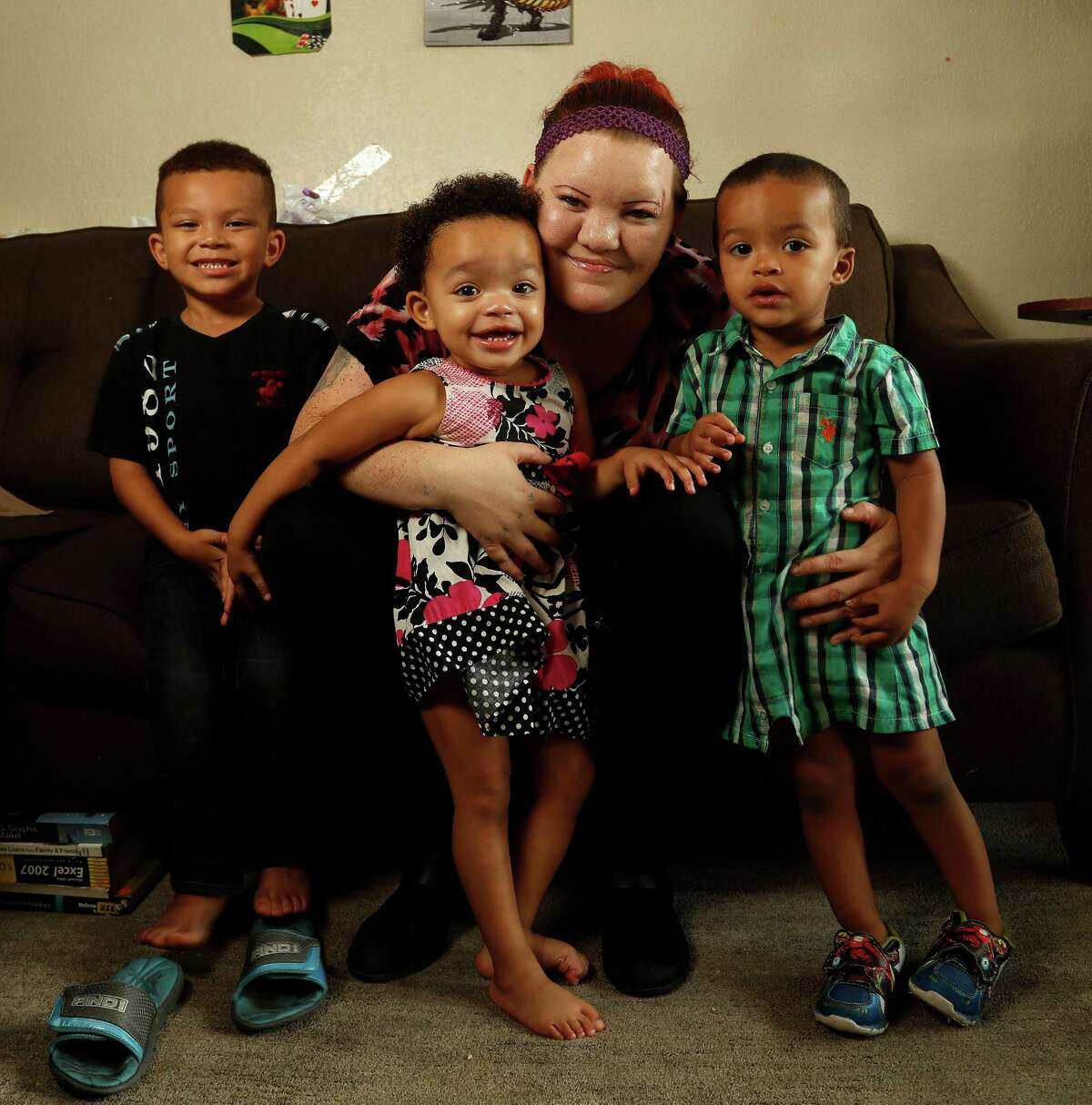 Tanya Raines, with her children Robert Hunt IV, 5, and twins Sophia and Brandon Hunt, 2, is among the 58,000 residents who so far have applied for a voucher from the Houston Housing Authority. Applicants are chosen by a lottery.