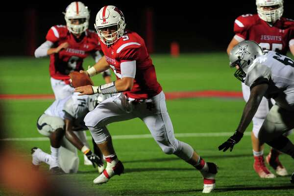 Unable to find an opening to pass the ball, Fairfield Prep quarterback Pat Conte takes off for the endzone and scores in the first half against Hillhouse on Friday in Fairfield.