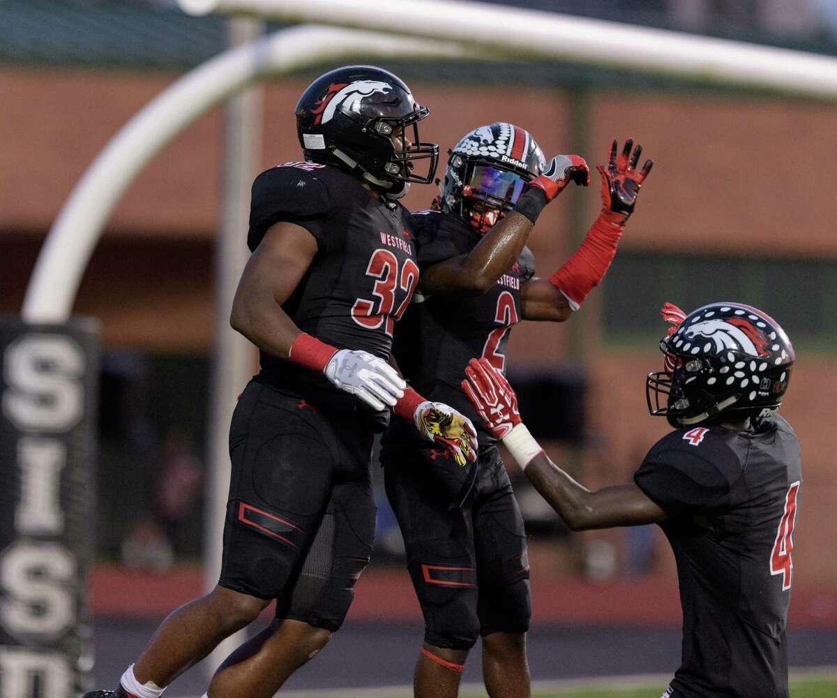 Sept. 23: Westfield 46, Spring 13 Daniel Young (32) of the Westfield Mustangs celebrates his touchdown with Ali Walter (2) and Jaylon Garrett (4) in the first half against the Spring Lions in a high school football game on Friday, September 23, 2016 at George Stadium in Spring Texas.