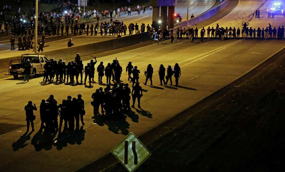 Police confront protesters blocking I-277 during demonstrations following Tuesday's police shooting of Keith Lamont Scott in Charlotte, N.C., Thursday, Sept. 22, 2016. (AP Photo/Gerry Broome) ORG XMIT: NCGB114 Photo: Gerry Broome / Copyright 2016 The Associated Press. All rights reserved.