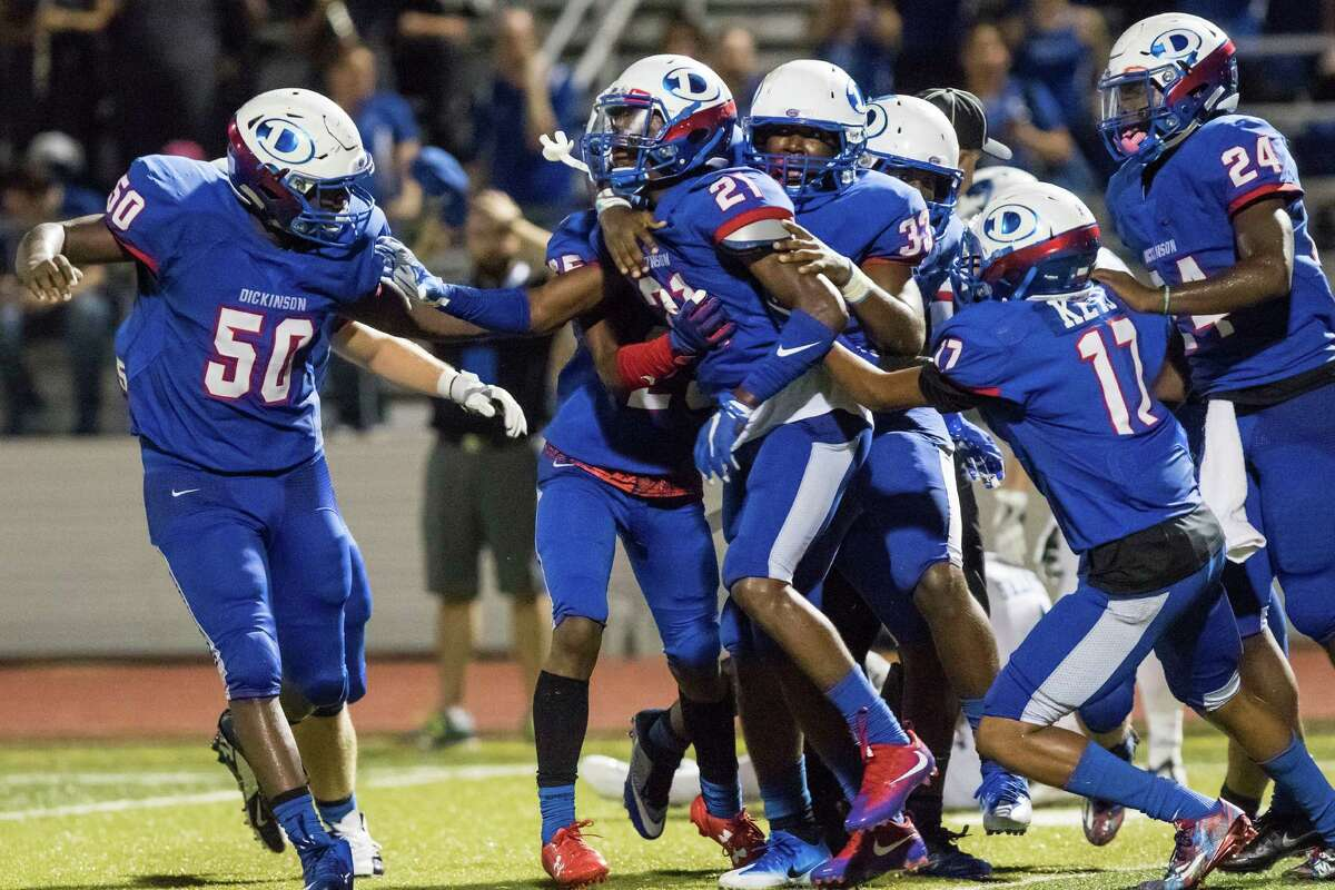 Dickinson defensive back DJ Small (21) and the rest of the defense celebrate after Small's game clinching interception in the fourth quarter of a District 24-6A high school football game at Sam Vitanza Stadium on Friday, September 23, 2016, in Dickinson.