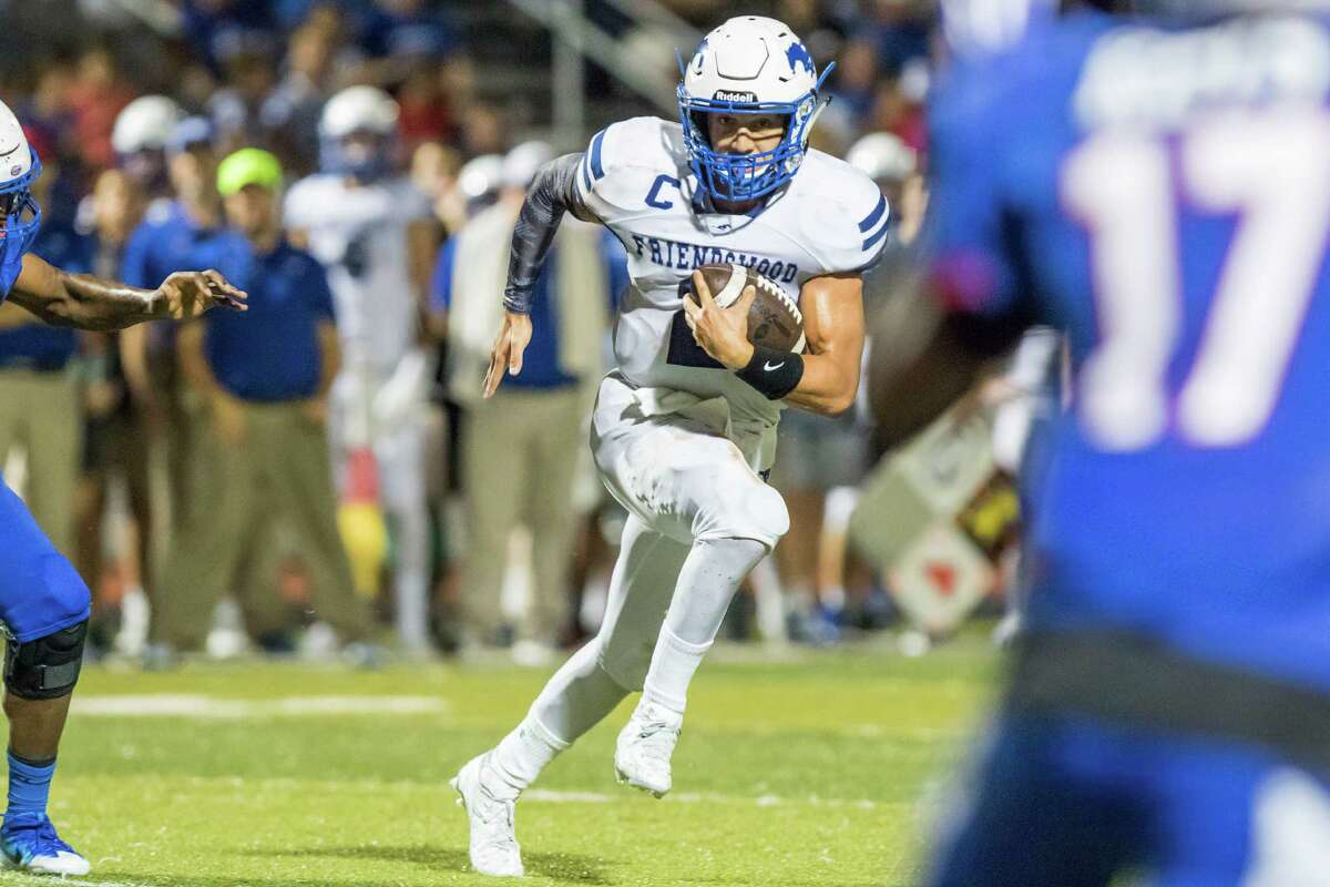 Friendswood quarterback Tyler Page (2) scrambles for positive yards in a District 24-6A high school football game at Sam Vitanza Stadium on Friday, September 23, 2016, in Dickinson.