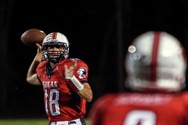 Foran's Lance DiNatale, Captain and QB throws a pass that connects with Jared Hubler in the first quarter of the game between Foran High School and North Haven at Foran in Milford, Friday, September 23, 2016.