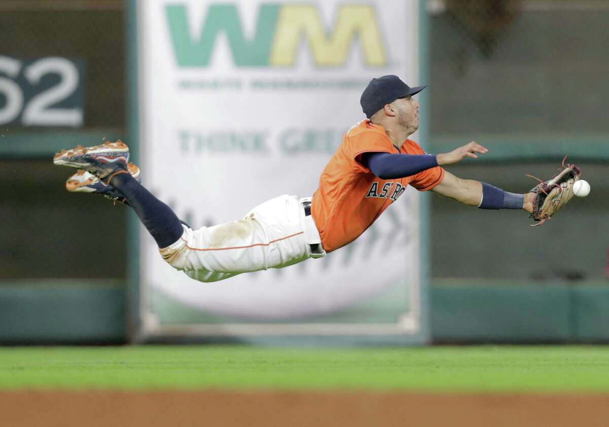 Houston Astros shortstop Carlos Correa (1) can't get to a hit by Los Angeles Angels left fielder Rafael Ortega (39) in the ninth inning. Photos of MLB game action between Houston Astros and Los Angles Angels on Friday, Sept. 23, 2016, at Minuet Maid Park in Houston.