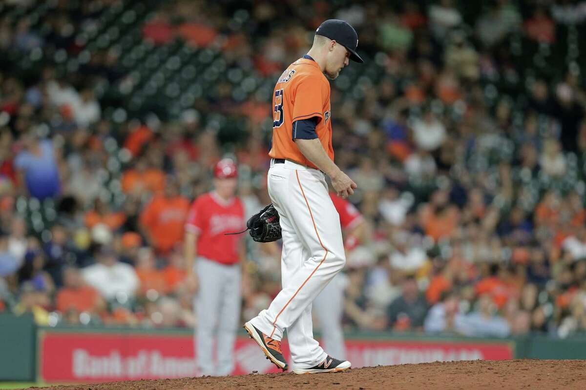 Houston Astros relief pitcher Ken Giles (53) reacts as he gets back to the mound after giving up a home run in the ninth. Photos of MLB game action between Houston Astros and Los Angles Angels on Friday, Sept. 23, 2016, at Minuet Maid Park in Houston.