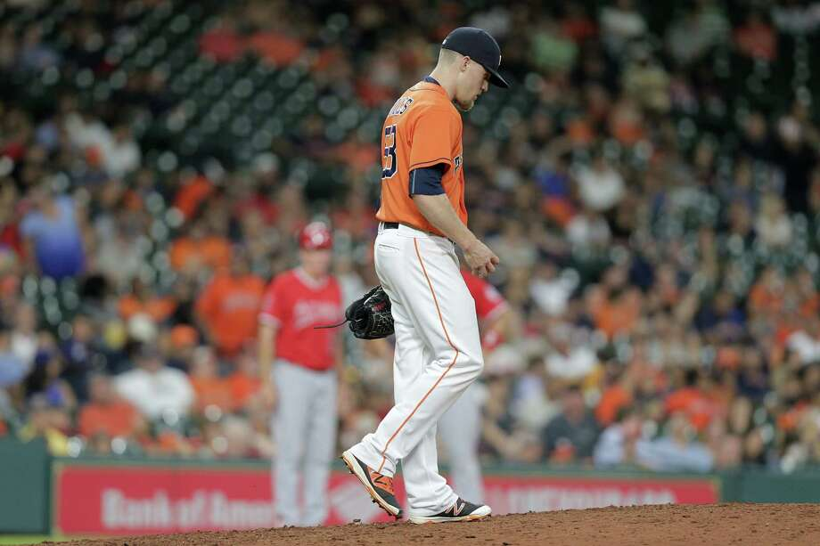 Houston Astros relief pitcher Ken Giles (53) reacts as he gets back to the mound after giving up a home run in the ninth. Photos of MLB game action between Houston Astros and Los Angles Angels on  Friday, Sept. 23, 2016, at Minuet Maid Park in Houston. Photo: Elizabeth Conley, Houston Chronicle / © 2016 Houston Chronicle