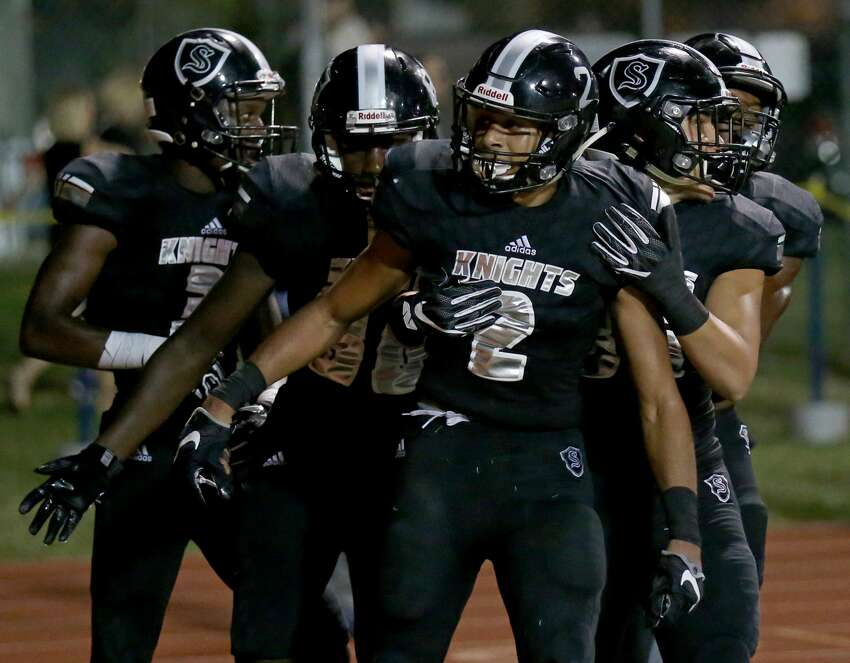 Steele's Caden Sterns (center) celebrates with teammates after a scoring a touchdown on an interception during second half action against Judson Friday Sept. 23, 2016 at Lehnhoff Stadium. Steele won 30-9.