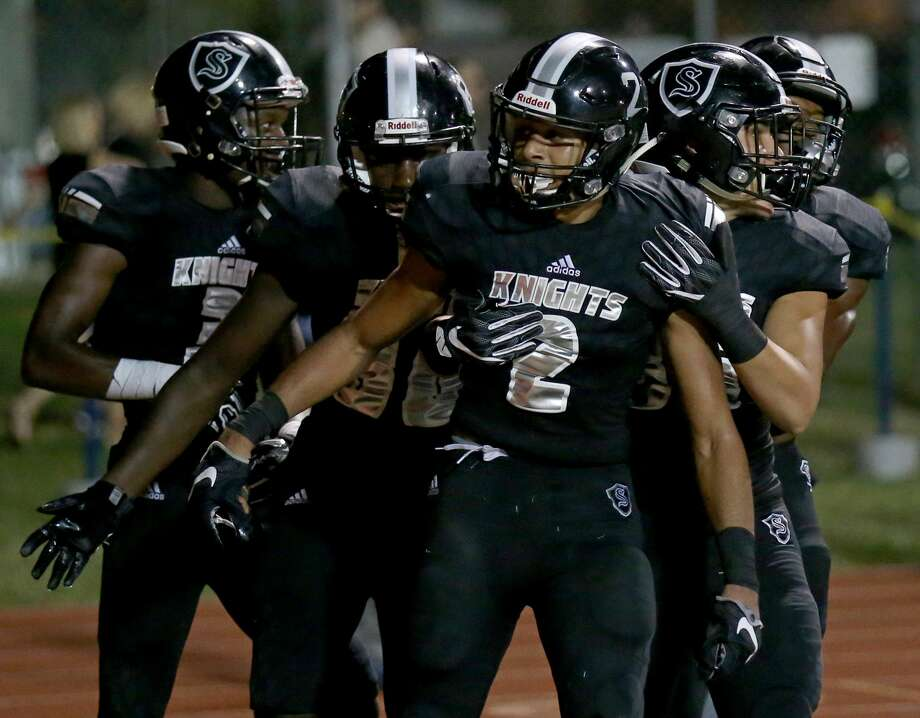 Steele's Caden Sterns (center) celebrates with teammates  after a scoring a touchdown on an interception during second half action against Judson Friday Sept. 23, 2016 at Lehnhoff Stadium. Steele won 30-9. Photo: Edward A. Ornelas/San Antonio Express-News