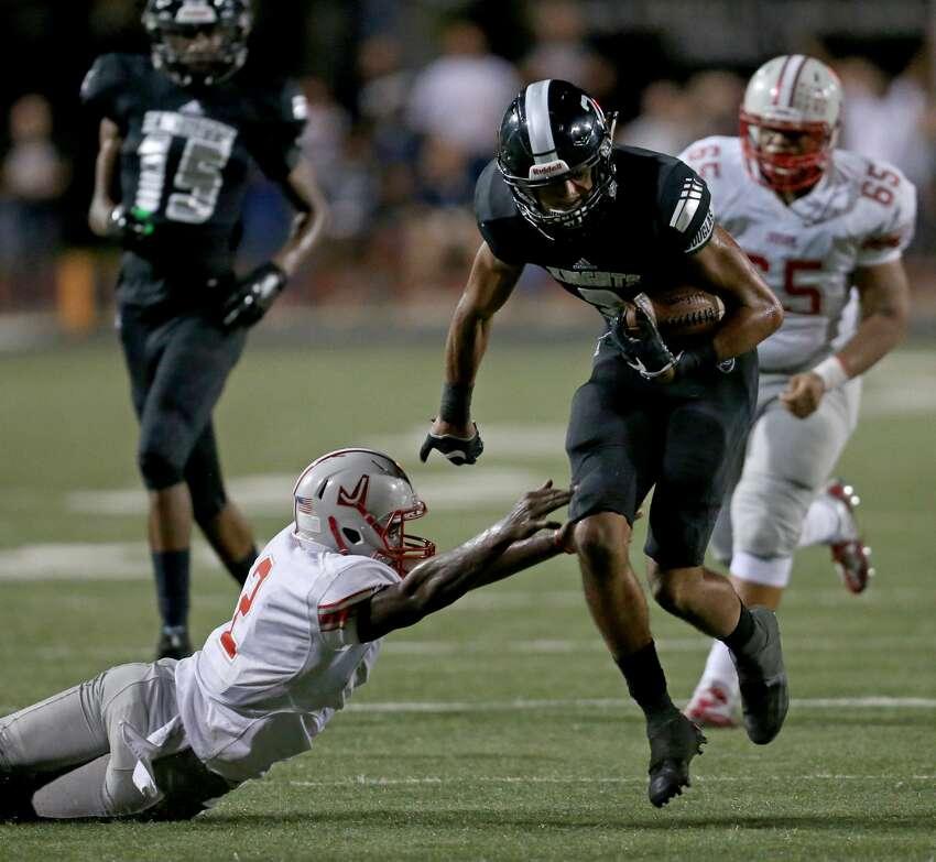 Steele's Caden Sterns heads to the end zone for a touchdown around Judson's Julon Williams on an interception during second half action Friday Sept. 23, 2016 at Lehnhoff Stadium. Steele won 30-9.