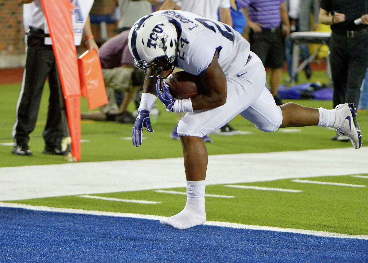 Texas Christian running back Trevorris Johnson (24) runs for a touchdown during the fourth quarter against Southern Methodist at Gerald J. Ford Stadium in Dallas on Friday, Sept. 23, 2016. TCU won, 33-3.