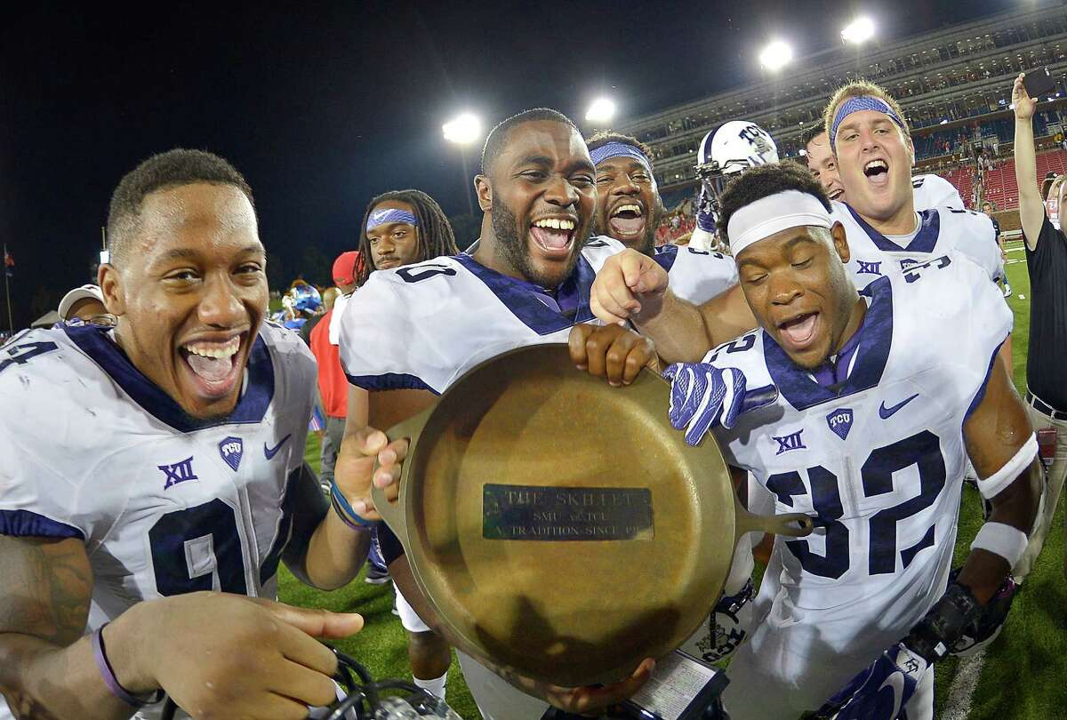Texas Christian Horned Frogs celebrate retaining the Iron Skillet with a 33-3 win against Southern Methodist at Gerald J. Ford Stadium in Dallas on Friday, Sept. 23, 2016.