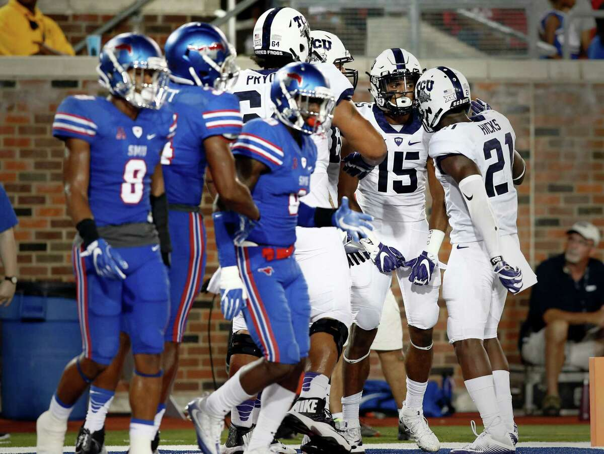 TCU wide receiver Jaelan Austin (15) celebrates with teammates after scoring against SMU in the second half of an NCAA college football game, Saturday, Sept. 23, 2016, in Dallas, Texas. TCU defeated SMU 33-3. (AP Photo/Mike Stone)