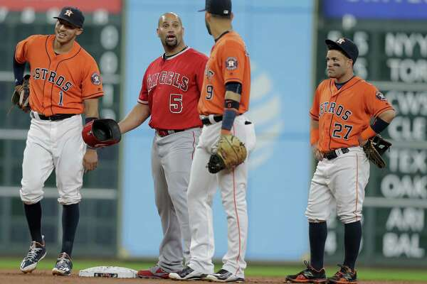 Angels designated hitter Albert Pujols (5) can't believe his hit was ruled foul in the second inning against the Astros. The call didn't hurt slow him too much, though, as he finished the 10-6 win with three hits and three runs.