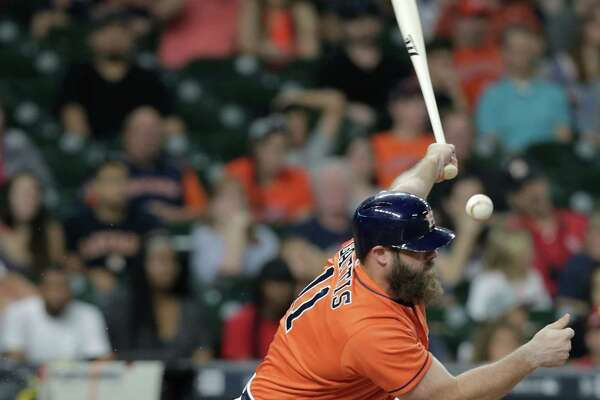 Houston Astros designated hitter Evan Gattis (11) fouls the ball in the second inning. Photos of MLB game action between Houston Astros and Los Angles Angels on  Friday, Sept. 23, 2016, at Minuet Maid Park in Houston. ( Elizabeth Conley / Houston Chronicle )