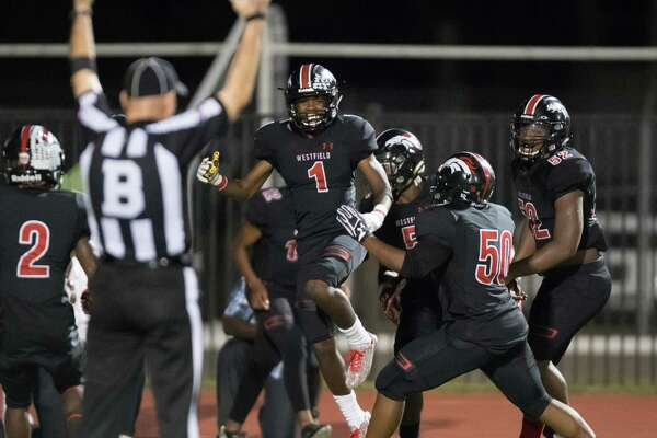 Rayshawn James (1) of the Westfield Mustangs celebrates his touchdown with his teammates in the second half against the Spring Lions in a high school football game on Friday, September 23, 2016 at George Stadium in Spring Texas.