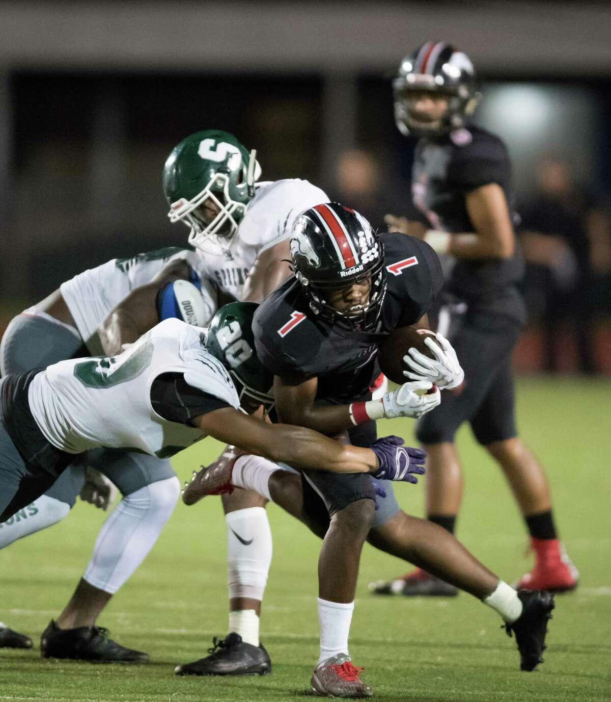 Rayshawn James (1) of the Westfield Mustangs runs up the middle in the second half against the Spring Lions in a high school football game on Friday, September 23, 2016 at George Stadium in Spring Texas.