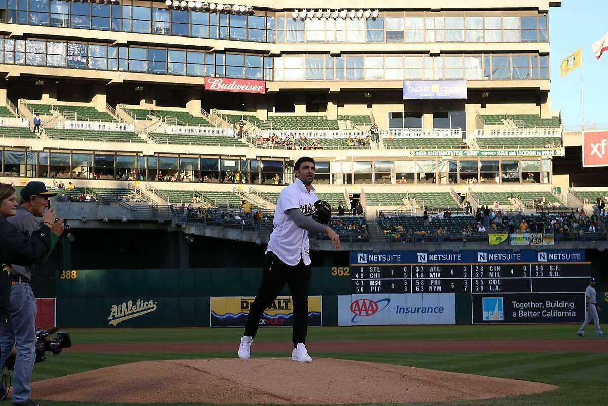 Warriors center Zaza Pachulia throws out the first pitch at Friday's A's-Rangers game.