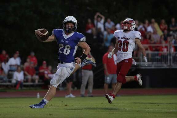 Episcopal's Jacob Levrier (28) scores on a touchdown reception, one of six thrown by quarterback Gavin Geib during Friday night's win over St. Thomas.