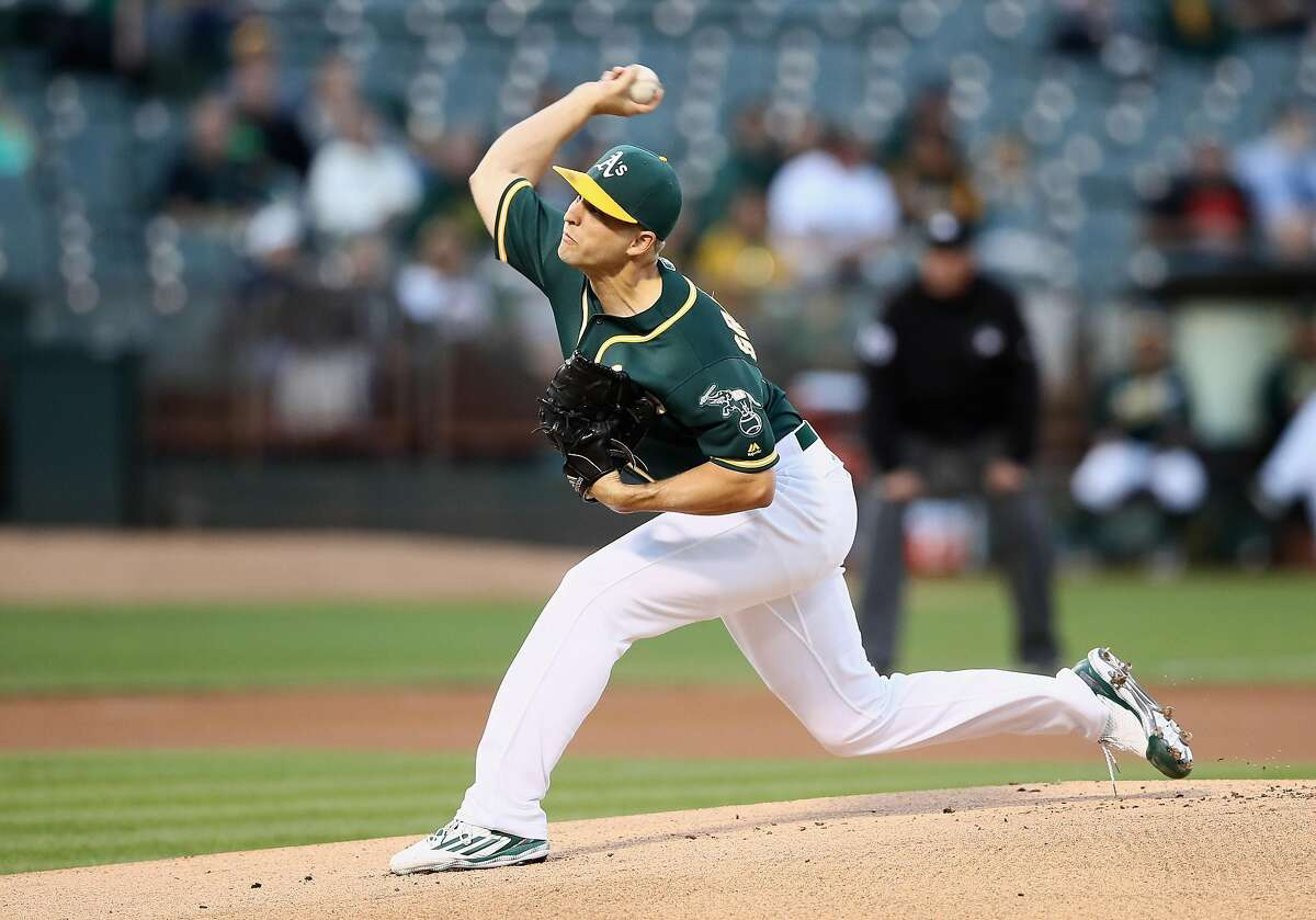 OAKLAND, CA - SEPTEMBER 23: Kendall Graveman #49 of the Oakland Athletics pitches against the Texas Rangers in the first inning at Oakland-Alameda County Coliseum on September 23, 2016 in Oakland, California. (Photo by Ezra Shaw/Getty Images)