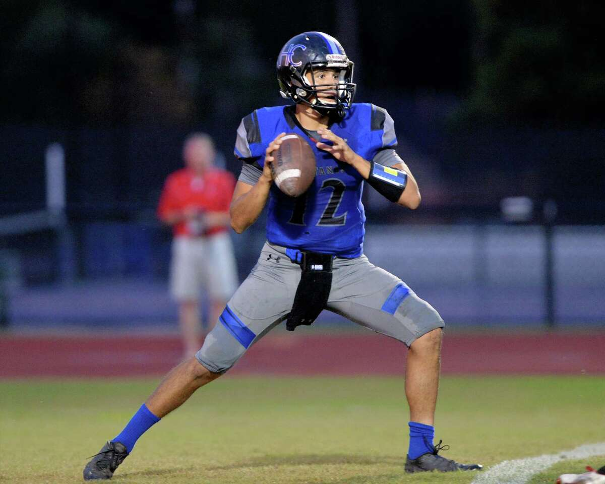 Mustang quarterback Evan Marshman (12) drops back to pass in the first quarter of a high school football game between the Houston Christian Mustangs and St. John's Mavericks on September 23, 2016 at Mustang Stadium, Houston, TX.