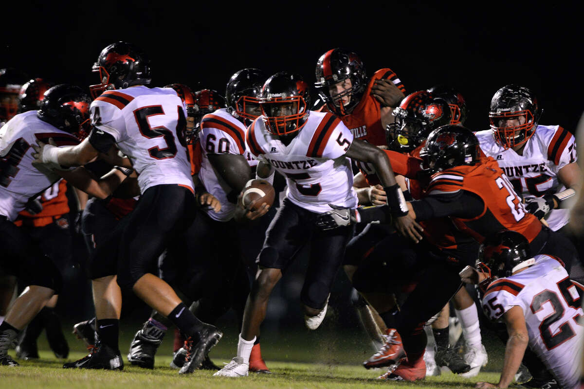 Kountze quarterback Dallion Edwards is tackled by Kirbyville players during the first quarter at Wildcat Stadium on Friday night. Photo taken Friday 9/23/16 Ryan Pelham/The Enterprise