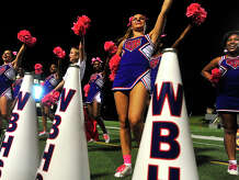 West Brook's cheerleaders work the crowd as the Bruins face Montgomery during Friday night's match-up at the Thomas Center. Photo taken Friday, September 23, 2016 Kim Brent/The Enterprise