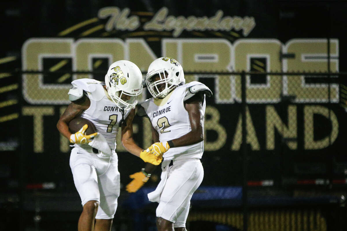 Conroe's Kelly McFarland (1) celebrates after scoring a touchdown with DeeMarcus Jackson (2) during the varsity football game against Oak Ridge on Friday, Sept. 16, 2016, at Woodforest Stadium in The Woodlands, Texas.