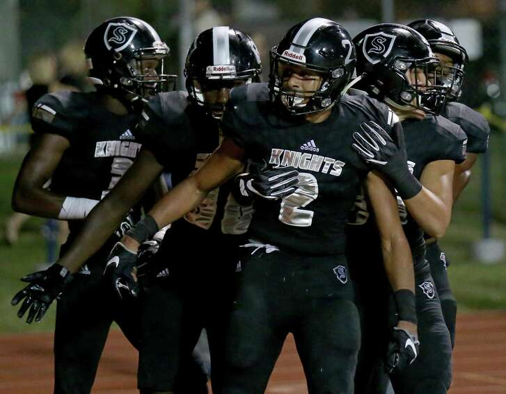 Steele's Caden Sterns (center) celebrates with teammates after a scoring a touchdown on an interception during second-half action against Judson on Sept. 23, 2016 at Lehnhoff Stadium. Steele won 30-9.