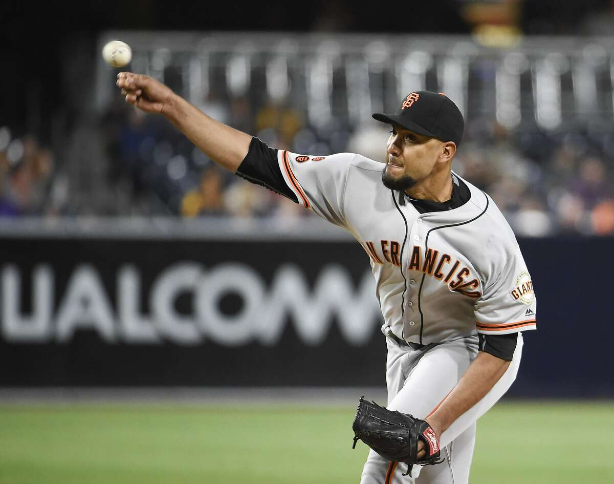 SAN DIEGO, CALIFORNIA - SEPTEMBER 23: Albert Suarez #56 of the San Francisco Giants pitches during the first inning of a baseball game against the San Diego Padres at PETCO Park on September 23, 2016 in San Diego, California. (Photo by Denis Poroy/Getty Images)