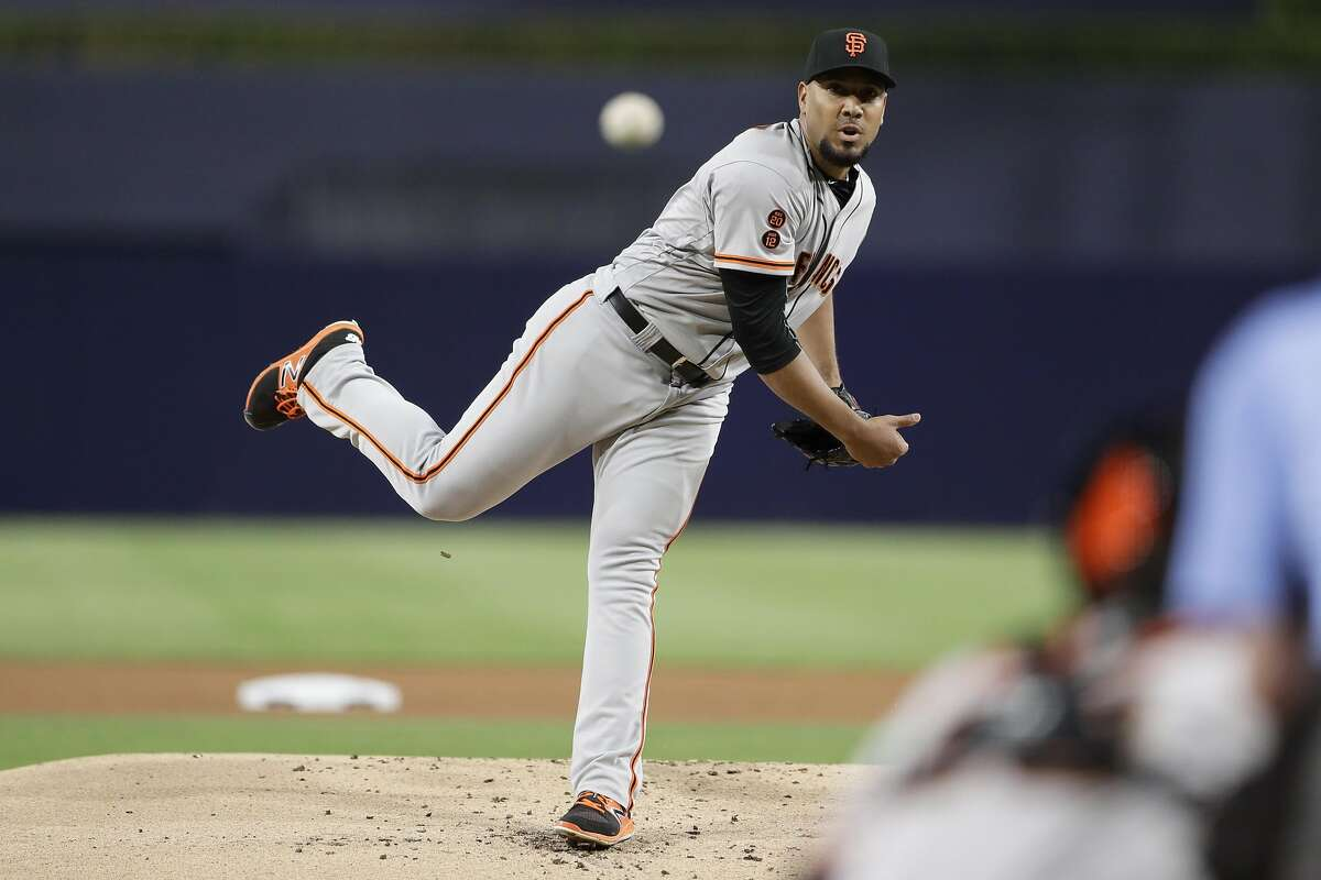 San Francisco Giants starting pitcher Albert Suarez works against a San Diego Padres batter during the first inning of a baseball game Friday, Sept. 23, 2016, in San Diego. (AP Photo/Gregory Bull)