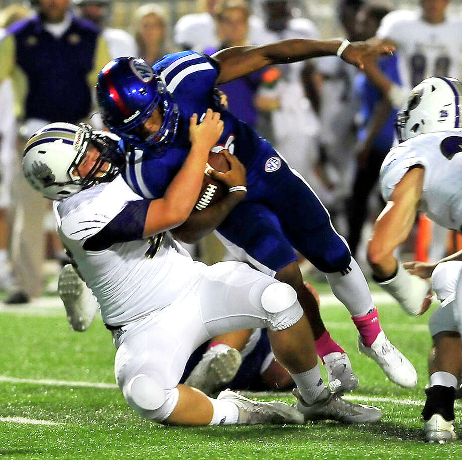 West Brook's Joel Denley is brought down by Montgomery's Wes May during Friday night's match-up at the Thomas Center. Photo taken Friday, September 23, 2016 Kim Brent/The Enterprise Photo: Kim Brent / Beaumont Enterprise