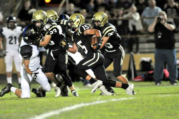 Nederland's Landon Hiltz takes the ball upfield for Nederland as the second quarter begins on Friday night during their game at Bulldog Stadium. (Mike Tobias/The Enterprise)