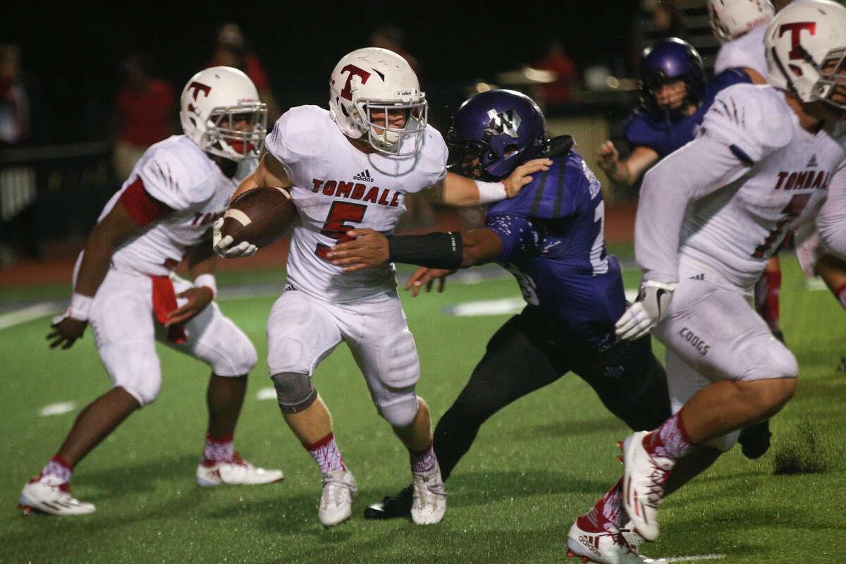 Willis' Tavion Brooks (23) tackles Tomball's Landry Sipe (5) during the varsity football game on Friday, Sept. 16, 2016, at Yates Stadium in Willis, Texas.