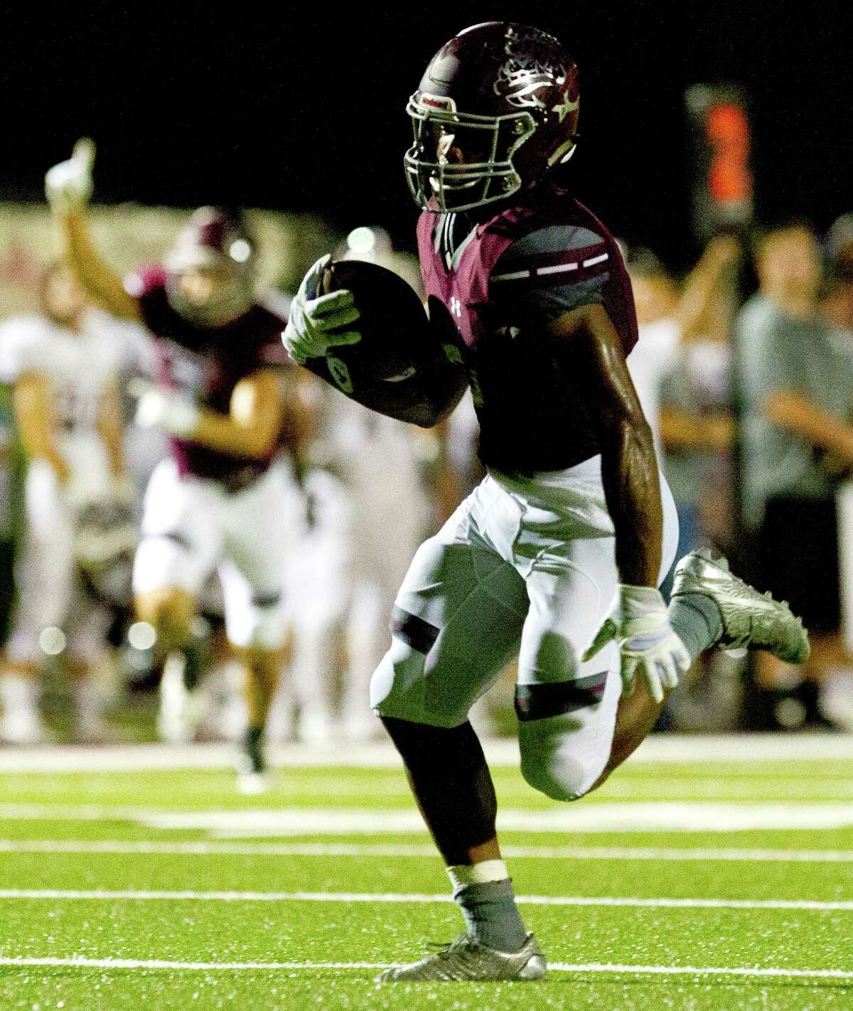 Magnolia wide receiver Anthony Johnson (5) runs after catching a pass from quarterback Jacob Frazier for a 48-yard touchdown during the second quarter of a District 21-5A high school football game Friday, Sept. 23, 2016, in Magnolia.