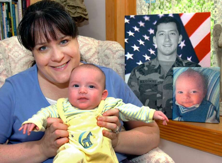 Nina Bowman-Sekscenski poses with her 12-week old son, Max Sekscenski, in their Stratford, Conn. home May 3rd, 2010. Max was conceived through in vitro fertilization shorty after the death of Nina's husband, William Sekscenski, last year. Photo: Ned Gerard / Connecticut Post