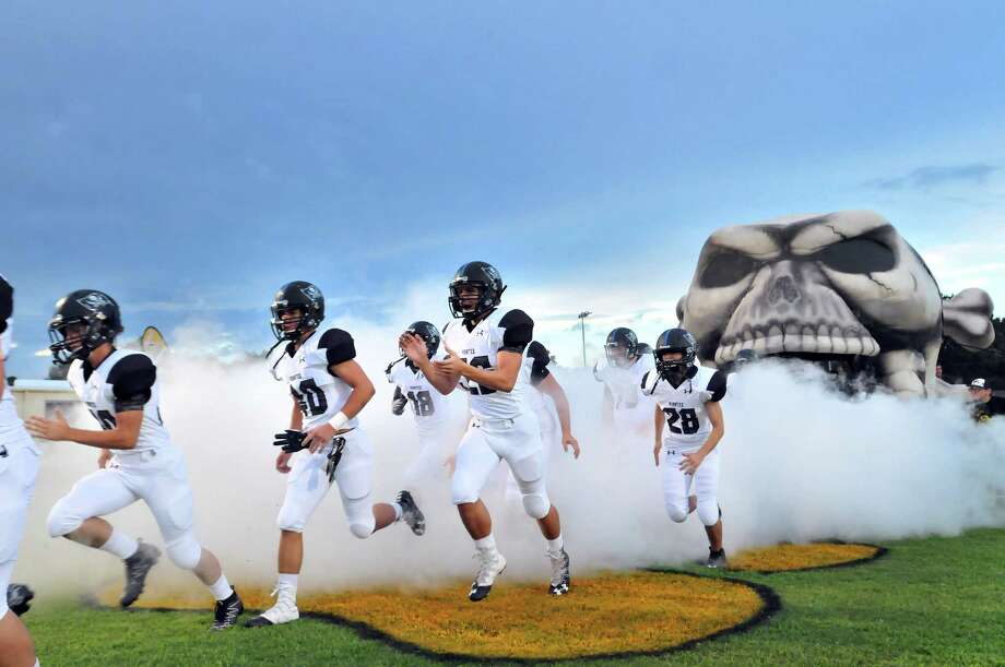 The Vidor Pirates take the field prior to Friday's game with the Nederland Bulldogs at Bulldog Stadium in Nederland. (Mike Tobias/The Enterprise) Photo: Mike Tobias/The Enterprise