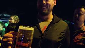A man touts his stein full of fresh beer at the Fremont Oktoberfest on Friday, September 23 in Seattle's Fremont neighborhood.