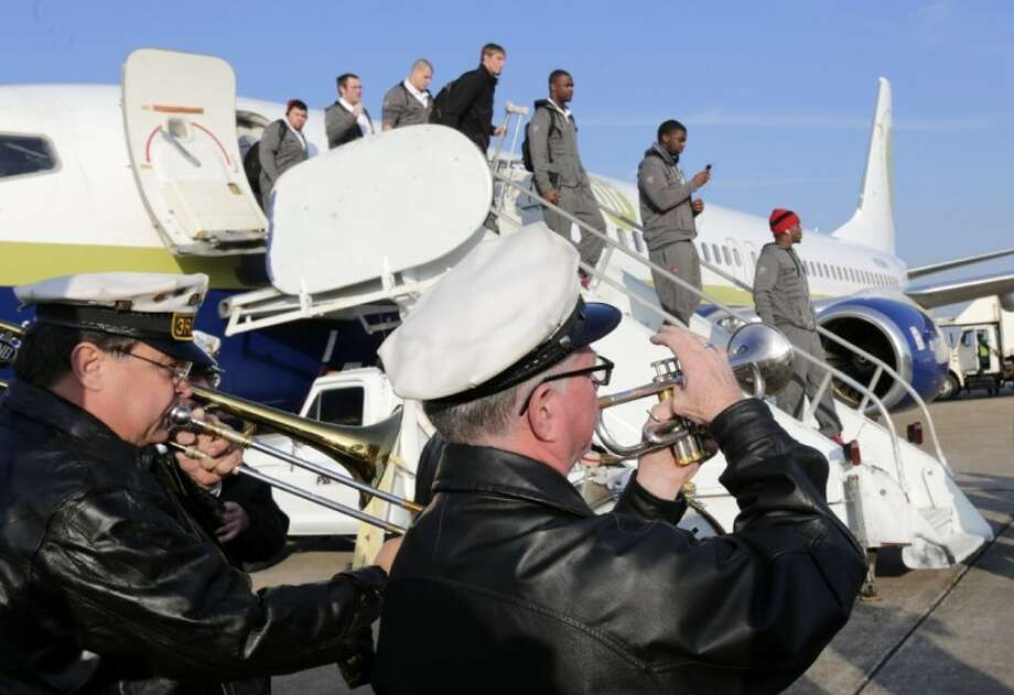 The Third Line Brass Band greets members of the Louisville football team as they deplane Thursday in New Orleans. Photo: Dave Martin