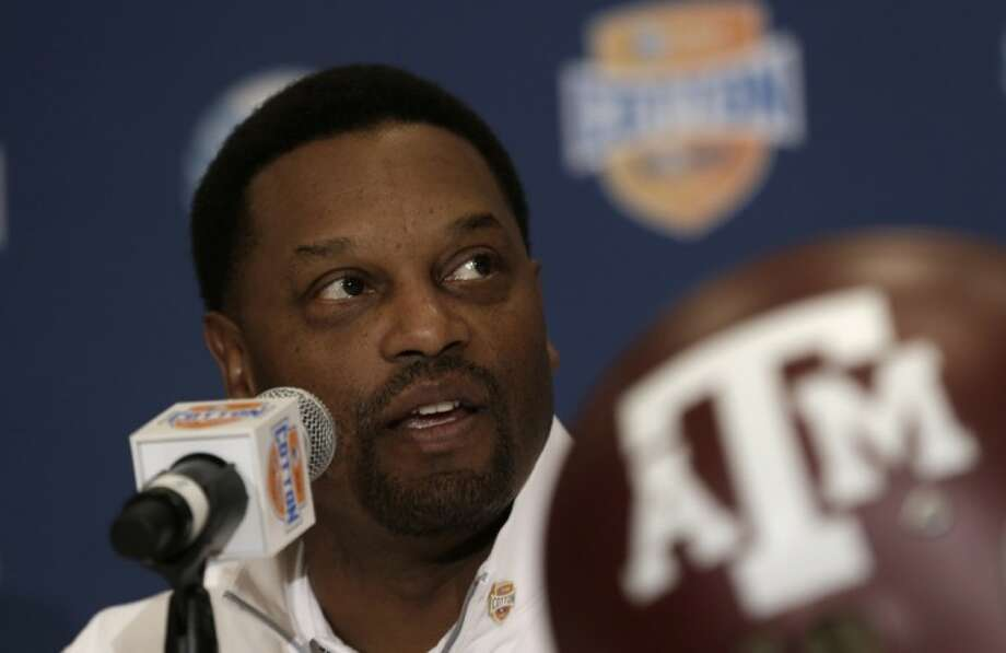 Texas A&M coach Kevin Sumlin answers a question during a news conference Wednesday leading up to the Cotton Bowl in Irving. Photo: LM Otero