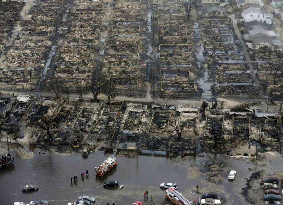 An Oct. 30, 2012, file photo shows an aerial view of burned-out homes in the Breezy Point section of the Queens borough New York after a fire in the beachfront neighborhood as a result of superstorm Sandy. Photo: Mike Groll