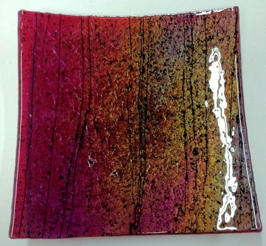 """A fused glass artwork, titled, """"Red Plate,"""" is currently on display at Liberty Artworks, 208-B, North Main Street, Conroe."""