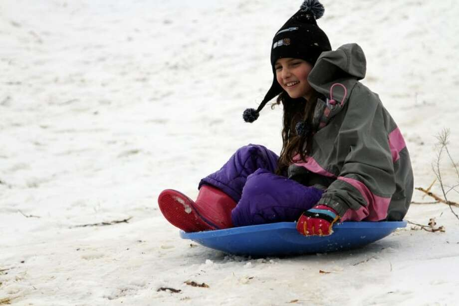 Natalia Guevara slides downhill in Memorial Park Friday, Jan 4, 2013 in El Paso. Texas. A winter storm dumped four inches of snow in the El Paso area, about half of one yearís total snowfall, causing schools, businesses and government institutions to close. Photo: Juan Carlos Llorca