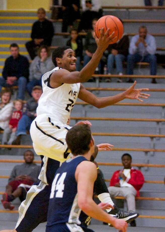 Conroe's Auther Harris goes up for a basket during Friday night's game at The Pit at Conroe High School. To view or purchase this photo or others like it, visit www.yourconroenews.com/photos. Photo: Staff Photo By Eric Swist