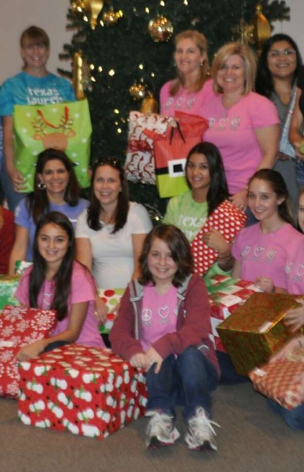Members of the Texas Laurels Chapter of the National Charity League wrapped more than 400 holiday gifts as part of Interfaith of The Woodlands Gifts for Senior's program.
