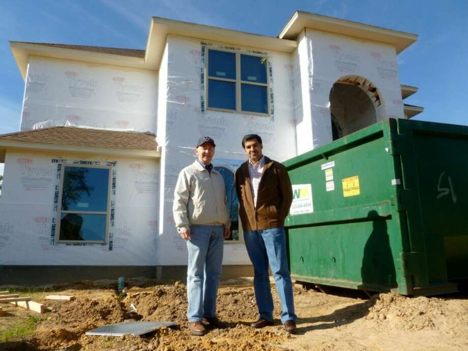 Developer and home builder John Lightfoot and N. Harris Malik, of Sunrise Custom Homes, add to the Champions Forest subdivision.