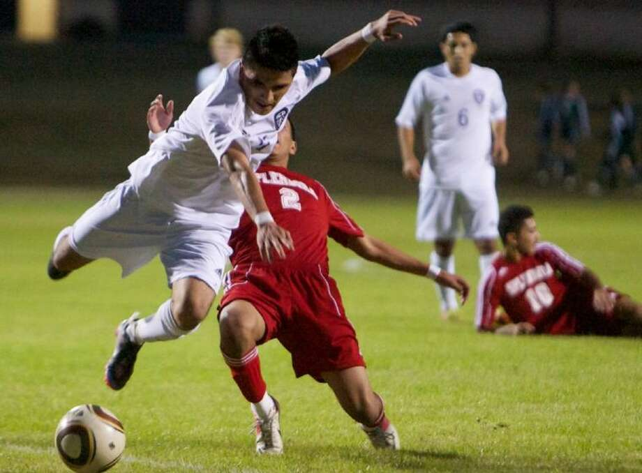 Splendora's Gabriel Luna tackles Willis' Candelario Martinez just outside the penalty area during Friday night's Kat Cup match at Brabham Middle School in Willis. Martinez scored the game's first goal on the ensuing free kick. Photo: Staff Photo By Eric Swist