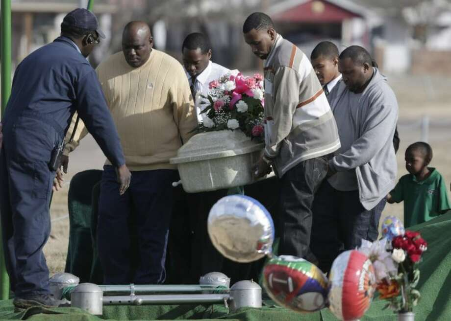 Pallbearers carry the small coffin holding six-year-old Tahlia Johnson on her way to her burial Friday in Dallas. According to Dallas health officials, Thalia's death on Tuesday was caused by the flu. It's unclear if she'd been vaccinated for the flu. State health officials say cases have been reported in more than half of Texas, and the intensity of flu-like symptoms is high. Photo: LM Otero / AP