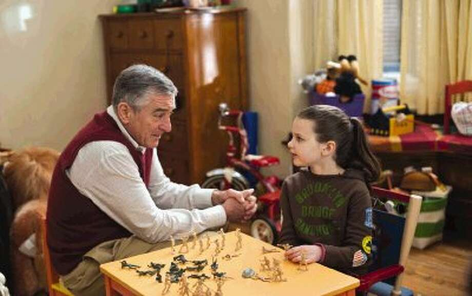 """In this film publicity image released by Universal Pictures, Robert De Niro, left, and Daisy Tahan are shown in a scene from """"Little Fockers."""" Robert De Niro and Ben Stiller's """"Little Fockers"""" remained the top draw at the weekend box office. / AP2010"""